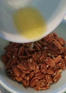 pouring butter into pecans